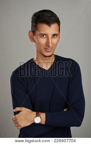 Modern Young Hispanic Man Portrait On Gray Background