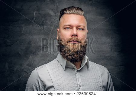Serious Bearded Male In A White Shirt On Grey Vignette Background.