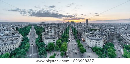 Wide Angle Sunset In The Skyline Of Paris With La Defense Business District And Wide Streets