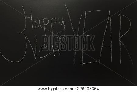 The Text Happy New Year On Black Board