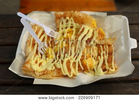 Asian Thai Famous Pancake With Banana Filling And Condensed Mild Topping