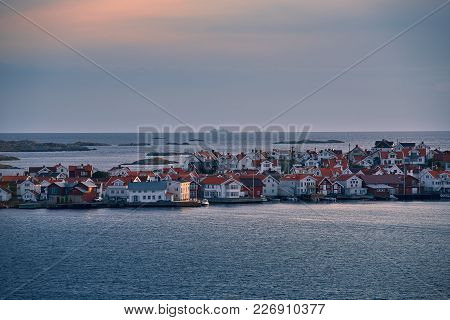 View At The Coastal City On An Island During Sunset.