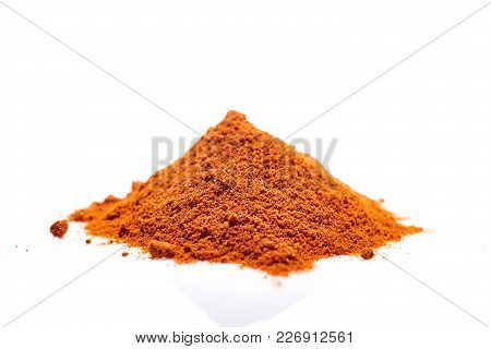 Close-up Picture Of A Pile Of Ground Powder Paprika Isolated On White Background