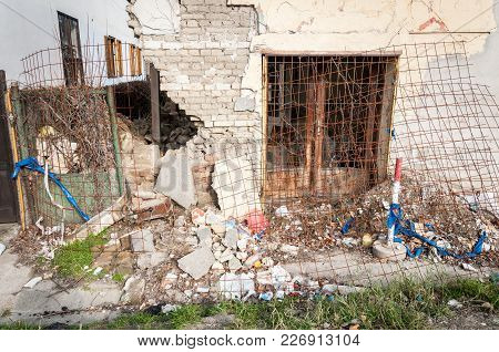 Remains Of Hurricane Or Earthquake Disaster Damage On Ruined Old House