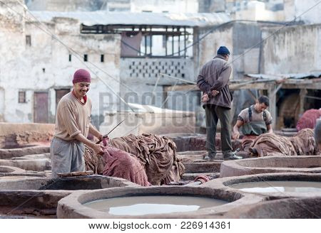 Fez, Morocco - January 4, 2014: Men Working Hard In The Tannery Souk In Fez, Morocco. The Tannery So