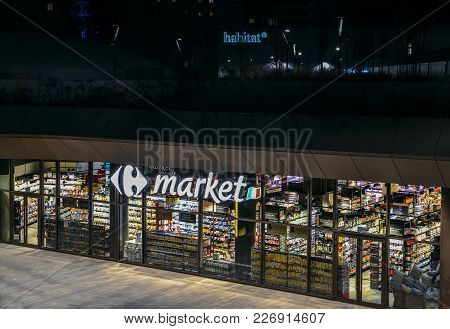 Milan, Italy - Feb 15, 2018: Retail Giant, Carrefour Supermaket, Closed At Night In The Citylife Dis