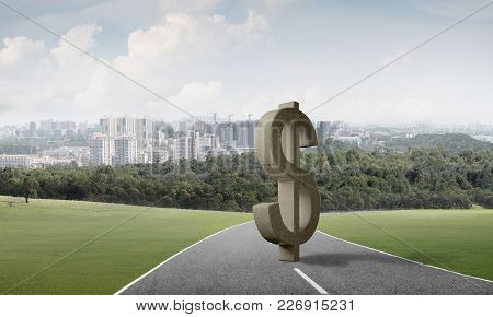 Stone Dollar Symbol On Natural Landscape As Currency Sign