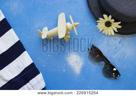 Get Ready To Flight. Tourist Or Travel Concept. Blue Powdered Background With Grey Hat, Sunglasses,