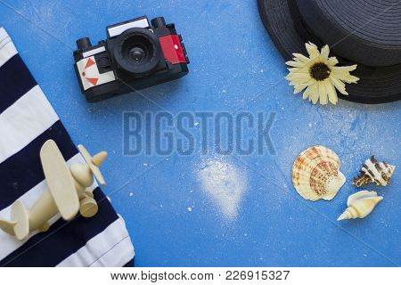 Preparing For Journey. Tourist Or Travel Concept. Blue Powdered Background With Grey Hat, Vintage Ca