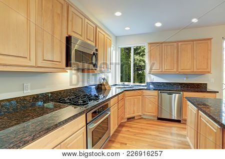 Sun Filled Gourmet Kitchen With Wooden Cabinetry
