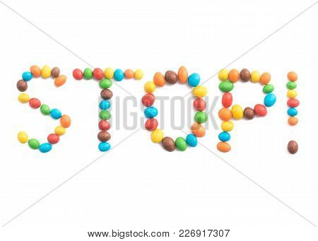 Word Stop, Made Of Multicolored Candies Isolated On White Background For Any Purpose