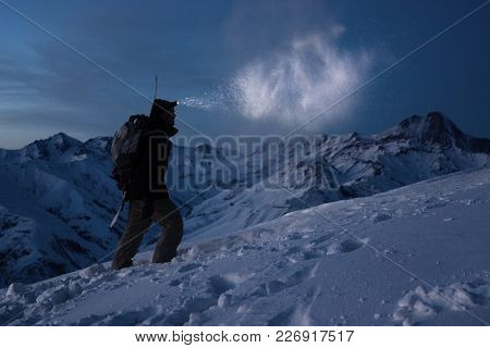Extreme Tourism. Brave Expeditor Lights The Way With A Headlamp At Night Winter Mountains. Man With