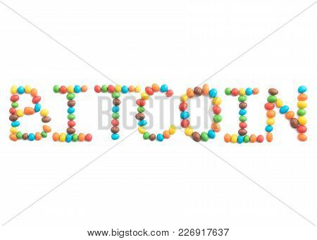 Word Bitcoin, Made Of Multicolored Candies Isolated On White Background For Any Purpose