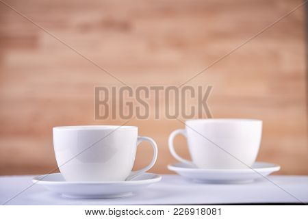 Two White Porcelain Tea Or Coffee Cups Arranged Together On Wood Texture Surface Show Clean And Simp