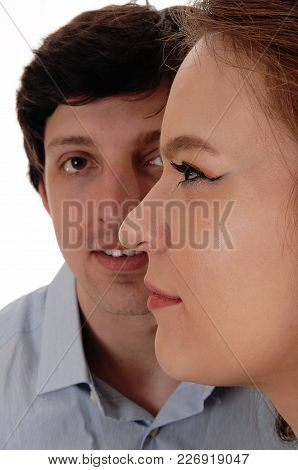 A Close Up Image Of The Faces Of A Young Couple With Her Face In Front Of His Face, Isolated For Whi