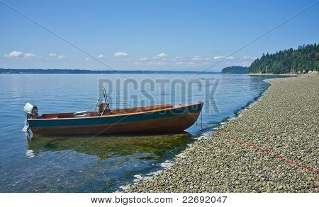 small wooden boat at shoreline