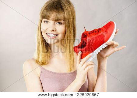Happy Sporty Smiling Woman Presenting Sportswear Trainers Red Shoes, Comfortable Footwear Perfect Fo