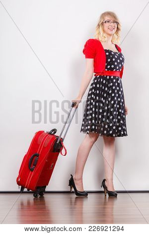 Traveling Vacation Concept. Elegant Young Woman In Full Length Wearing Polka Dot Black Dress High He