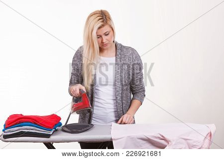 Household Duties, Domestic Chores Concept. Happy Woman Holding Iron About To Do Ironing
