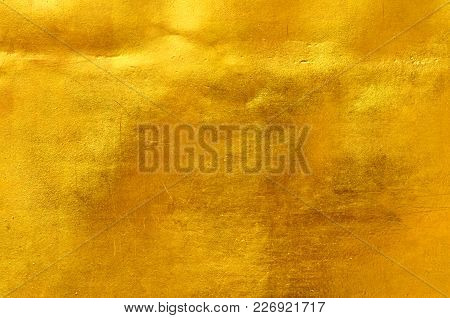 Gold Color Metal Wall Surface Texture, A Closeup Photo Image On Surface Of Vergolden Metal Plate On
