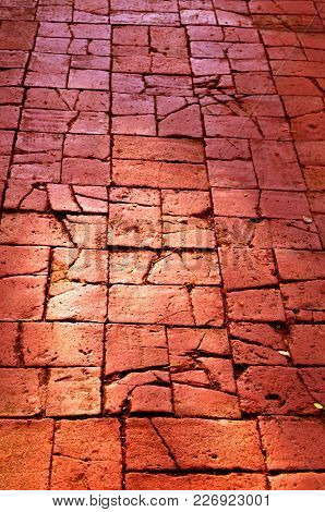 Uneven Brick Pavement, A Select Focus On An Old Uneven Pavement That Pave By Rectangle Maroon Color