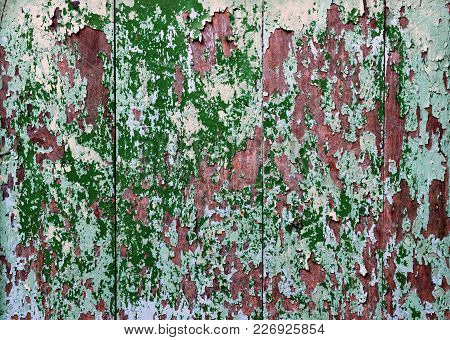 Grunge Stain Of Peel Color On Wooden Wall, Closeup Photo Of Green Grunge Stain On A Wood Wall Presen