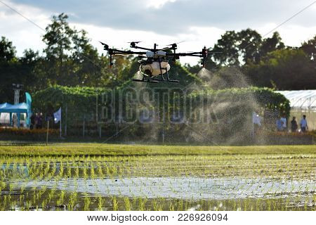 Carrying Agriculture Drone, Photo Image Of Agriculture Drone Carry A Tank Of Liquid Fertilizer Flyin