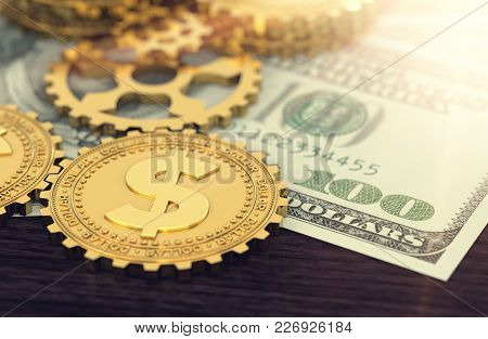 Dollar Coins In The Guise Of Cog As A Part Of Bigger Machine, Laying On Dollar Bill In Blurry Close-