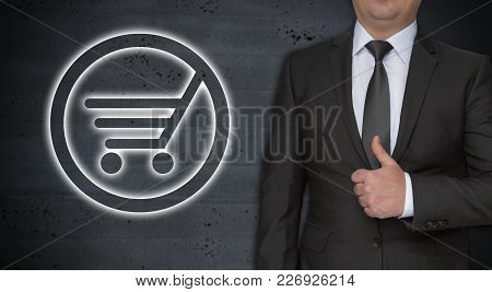 Shopping Cart Concept And Businessman With Thumbs Up.
