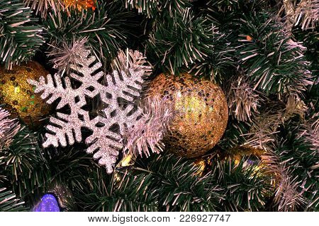 Christmas Tree Decoration, Christmas Tree That Decorate By Silver Snowflakes, And Golden Xmas Balls