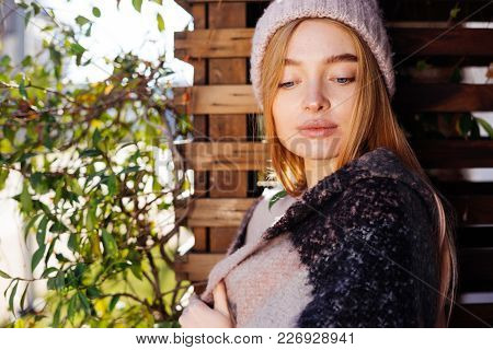 Cute Young Blonde Girl In Hat Posing, Thinking About Something