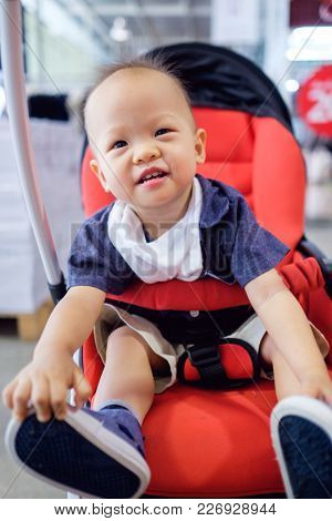 Happy And Cute Asian Baby Toddler Boy Sitting On Stroller Shopping In The Department Store, Smiling