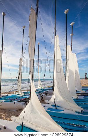 Playa Paraiso, Mexico - February 4, 2018: Colorful Sail Catamarans On The Beach At Caribbean Sea Of
