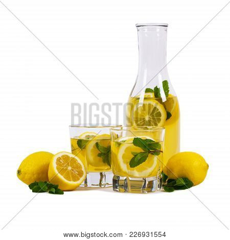 Lemonade Drink With Lemon Juice Isolated On White Background. Selective Focus.