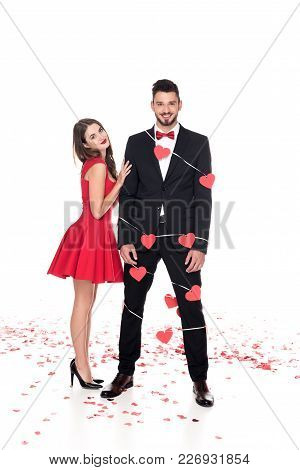 Girlfriend Standing Near Boyfriend Bound With Garland Of Hearts Isolated On White, Valentines Day Co