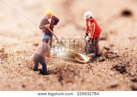 Gold Digging Treasure Search Concept. Figurines In Sand