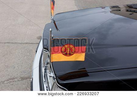 Flag Of German Democratic Republic On A Black Car