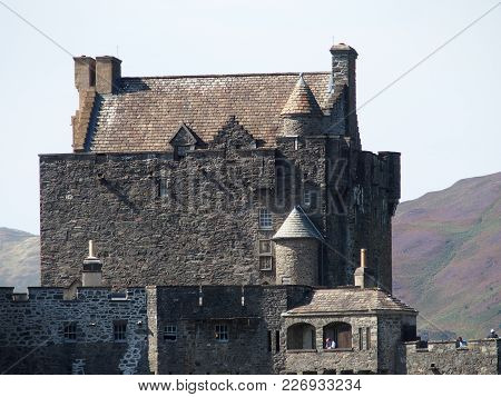 Eilean Donan Castle In Scotland, Celtic Medieval Scottish Stone Monument On Island At Lake Loch Duic