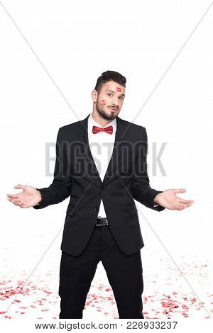 Man With Lips Traces On Face Showing Shrug Gesture Isolated On White, Valentines Day Concept