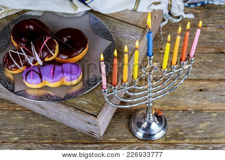 Image Of Jewish Holiday Hanukkah With Menorah Traditional Candelabra And Donuts