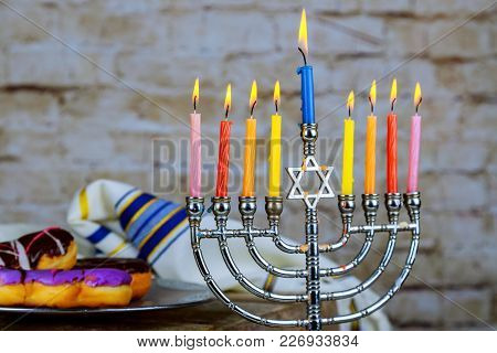 Selective Focus Image Of Jewish Holiday Hanukkah With Menorah Traditional Candelabra And Donuts