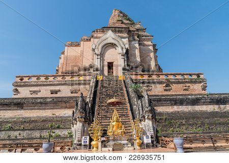 Chiang Mai, Thailand - January 29 2018; Gold Buddha Statue With Donation Boxes At Foot Of Steps Of L