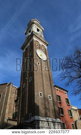 Ancinet Bell Tower With Big Clock Of The Church Of Santi Apostoli In Venice Italy