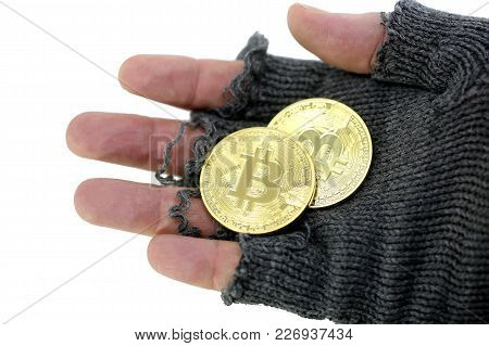 Concept Of The Risk Of Virtual Currency Markets With Hand Of Poor Man Holding Two Golden Bitcoin Coi