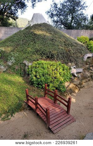 A Japanese Garden On The Theme Of Mount Fuji With Its Dragon Coming Out Of The Ground