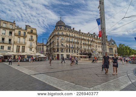 Montpellier, France - July 13, 2015: Unidentified People At Place De La Comedie In Montpeller, Franc