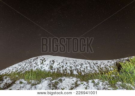 Starry Night Sky Over The White Cretaceous Hill. Night Natural Scape With Chalk Ridge. Natural Archa