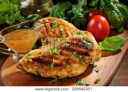 Tender, Juicy Chicken Breast Grilled With Vegetables Ingredients And Dressing For A Warm Salad