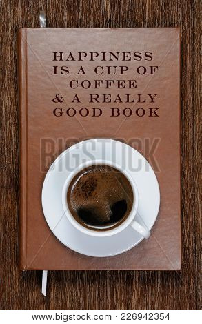 Happiness  Is A Cup Of  Coffee & A Really  Good Book . A Book With A Motivational Quote And A Cup Of