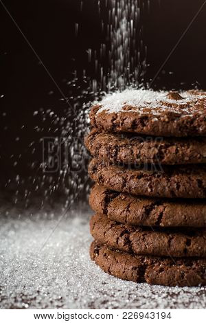 Stack Of Chocolate Chip Cookies On Brown Background. Stacked Chocolate Chip Cookies Shot With Select